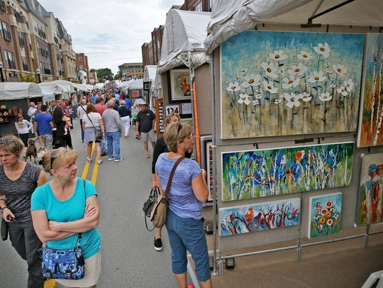 Art lovers wander from booth to booth at the Carmel