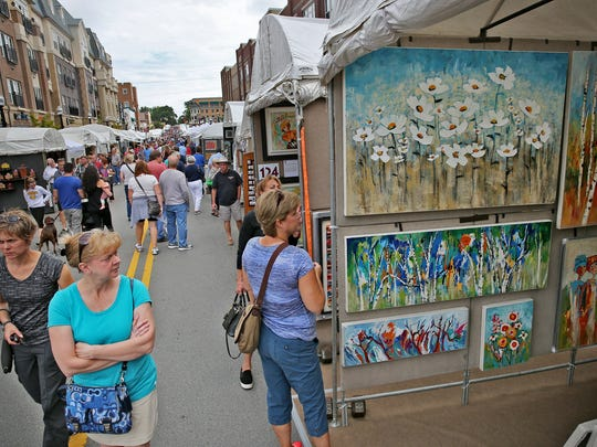 Art lovers wander from booth to booth at the Carmel International Arts Festival.