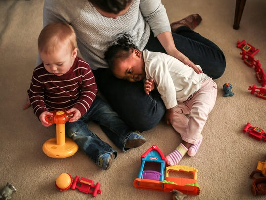 Julia Fenton, 1, of Canton plays with her brother Daniel