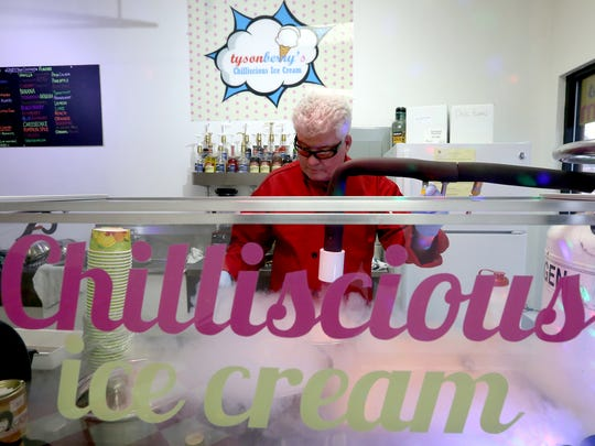 Owner Tyson Mayberry makes ice cream using liquid nitrogen at Tysonberry's Chilliscious Ice Cream on Commercial Street SE.