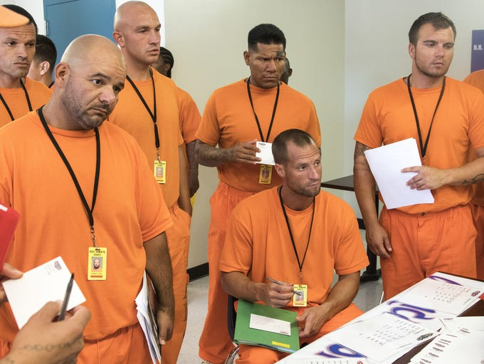 Prison inmates meet employers to fill out job applications