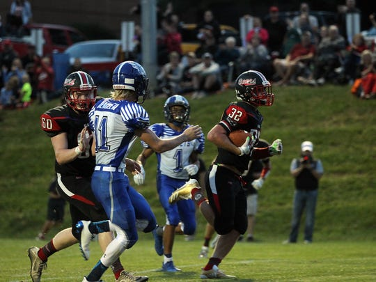 West Branch's Tanner Lukavsky runs in for a touchdown
