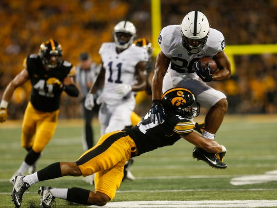 Iowa's Amani Hooker tackles Penn State's Saquon Barkley