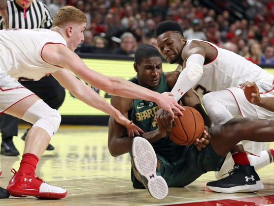 Jan 28, 2018; College Park, MD, USA; Michigan State forward Jaren Jackson wrestles for the ball with Maryland guard Kevin Huerter, left, and forward Bruno Fernando at XFINITY Center.