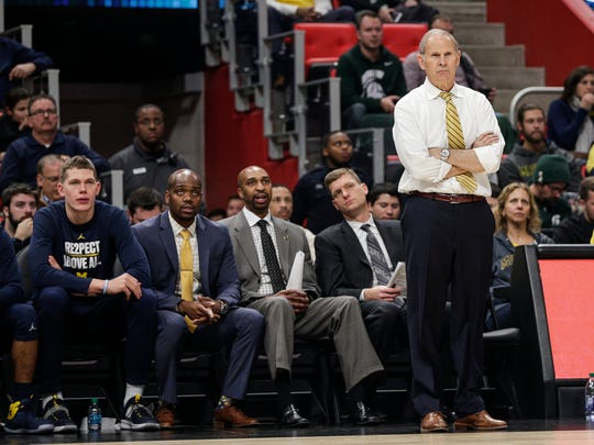 Michigan head coach John Beilein, right, and (left to right) Michigan forward Moe Wagner, and assistant coaches DeAndre Haynes, Saddi Washington and Luke Yaklich, watch a play during the second half against Detroit Mercy at Little Caesars Arena in Detroit, Saturday, Dec. 16, 2017.