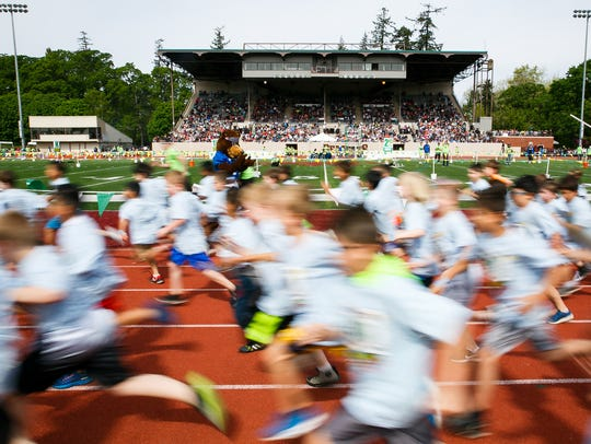 Second grade boys run in the 36th annual Awesome 3000