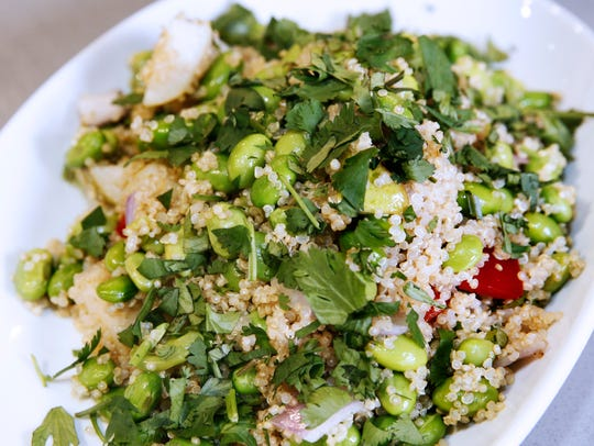 White quinoa, edamame, pear and red bell pepper combine