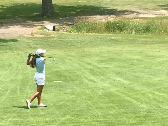 Leila Raines hits an approach shot on the first hole