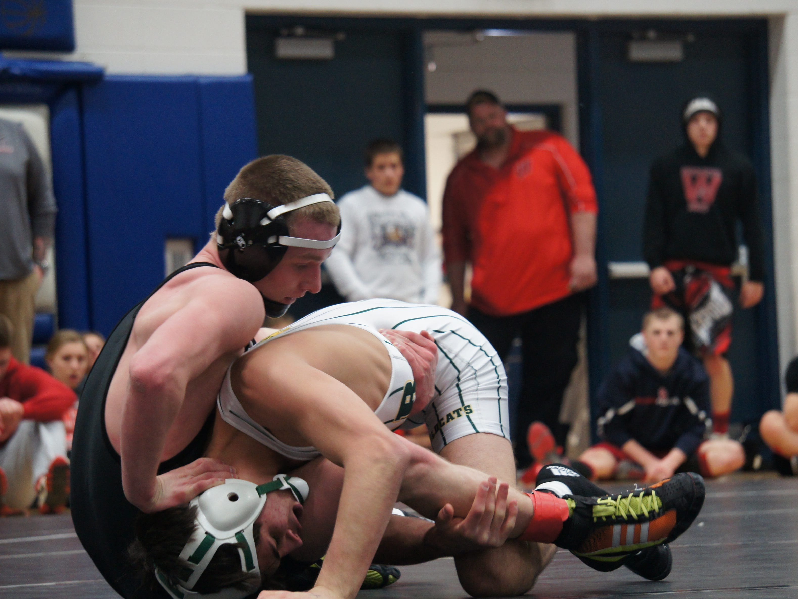 Edgar freshman Veliko Kochiu, right, works to control Stratford's Anthony Gliniecki in the 120-pound finals at the D3 regional at Auburndale on Saturday.