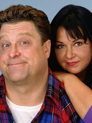 John Goodman, left, and Roseanne Barr, seen in a 1990s photo during the original run of 'Roseanne,' could be back on TV in a revival of that hit sitcom.