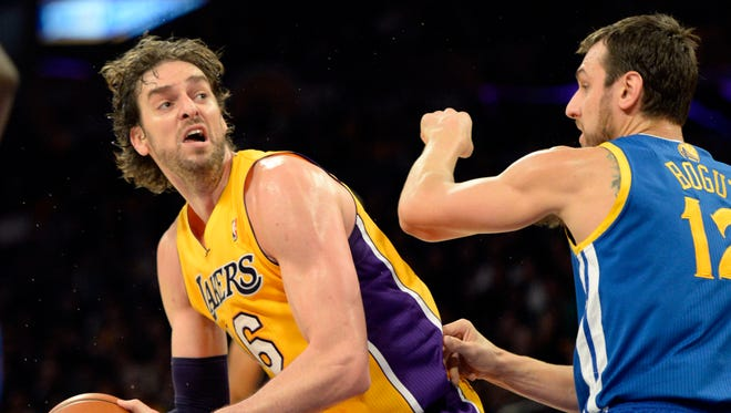 Los Angeles Lakers center Pau Gasol (16) drives against Golden State Warriors center Andrew Bogut (12) during the second half at Staples Center.