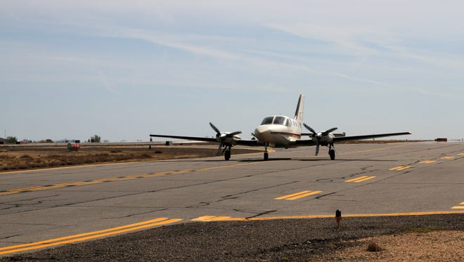An airplane taxis down a runway on April 22 at the Four Corners Regional Airport in Farmington.