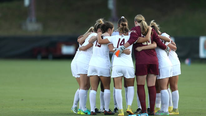 FSU players huddle up before their game against UConn at the Seminole Soccer Complex Thursday.