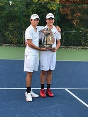 Seaholm's No. 2 doubles team of Owen (left) and John Cross won the regional championship.