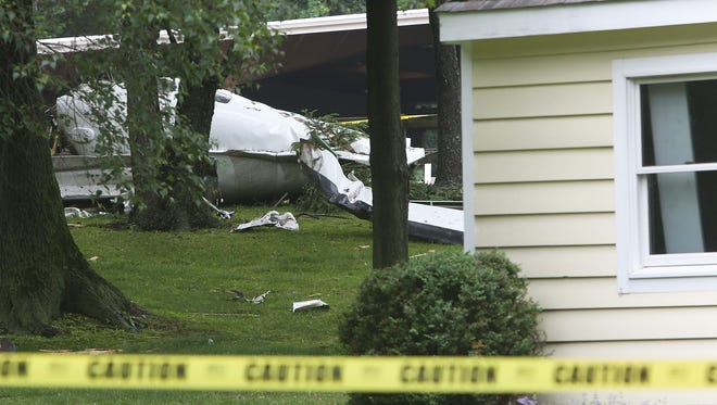The wreckage of a plane that crashed shortly after take off from Westchester County Airport sits in the yard of a home at 120 Cottage Avenue in Purchase June 13, 2014. Dr. Richard Rockefeller, the pilot of the plane was killed in the crash.