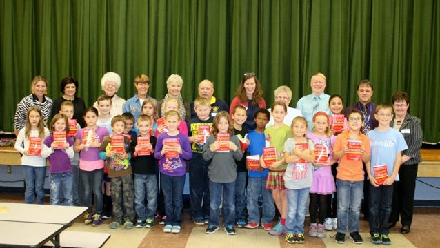 Bath Rotary Club presents dictionaries to all third graders at Vernon E. Wightman Primary School in Bath. Displaying their new dictionaries are the students in Laura Ford's class. In the back row are Ford; Deborah Barlow, principal; Bath Rotarians June Bates, Becky Stranges, Robin Lattimer, Neal Wrinkle, Terry Northrup, Vicki Anderson, William White, Joe Rumsey and Elaine Tears.