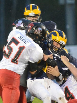 Pinckney's Cauy Hendee makes one of his 13 tackles against Hartland, stopping Brad Ekonen.