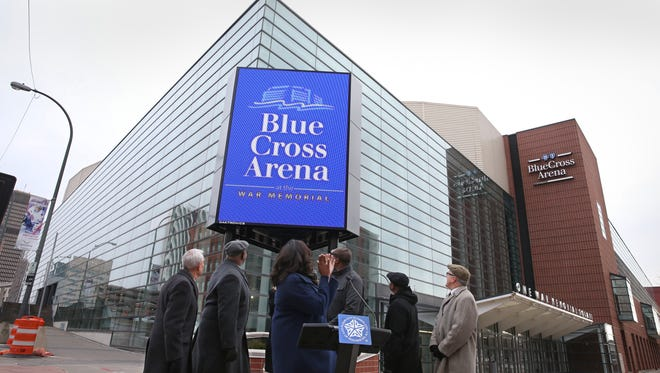 Mayor Lovely Warren lights up the new three-sided marquee outside the Blue Cross Arena in downtown Rochester Wednesday, Dec. 28, 2016.