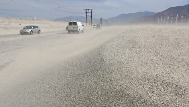 Sand whipped up by the wind pelts drivers travelling on Indian Canyon Monday afternoon, May 5, 2014.