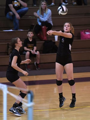 Lexington's Josie Boner hits the ball during the second round of playoffs at home against Bellevue on Thursday night.