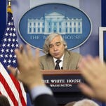 Members of the media raise their hands during a briefing in July by Energy Secretary Ernest Moniz in Washington.