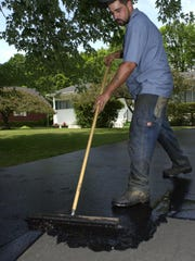 Is your driveway sealer scamming you? Here are some tips to protect yourself. (File photo)