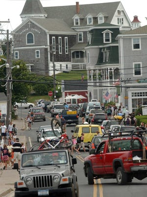 After the island's second fatal crash in a week, the Block Island Town Council discussed what it could do to make the roads safer. Safety for mopeds and motorists was a concern back when this photo was taken in 2003.