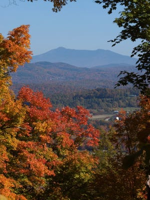 Mt. Mansfield is framed by foliage in this view to the east from Mt. Philo in Charlotte.