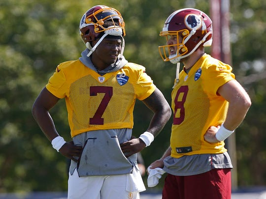 Jul 25, 2019; Richmond, VA, USA; Washington Redskins quarterback Dwayne Haskins (7) and Redskins quarterback Case Keenum (8) stand on the field during drills as part of day one of Redskins training camp at Bon Secours Washington Redskins Training Center. Mandatory Credit: Geoff Burke-USA TODAY Sports