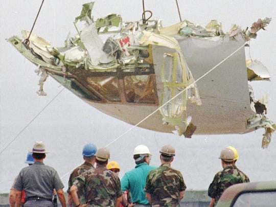 The cockpit of TWA Flight 800 is lowered Wednesday Aug. 7, 1996 at the U.S. Coast Guard station at Shinnecock Inlet in Hampton Bays, N.Y. Three weeks prior, all 230 people on board a flight from New York to Paris died when the plane exploded and fell into the Atlantic Ocean. The cause of the crash is still undetermined.