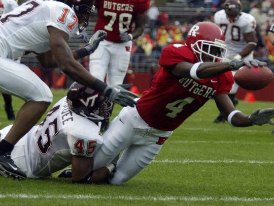 Rutgers wide receiver Shawn Tucker dives for the end zone in 2004.