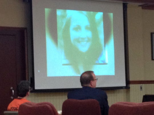 A video celebrating Alisha Bromfield's life was played during the sentencing of Brian M. Cooper, who killed the 21-year-old Plainfield, Ill., woman and her unborn daughter during a visit to Door County. Watching the screen are Cooper and defense attorney John Birdsall.