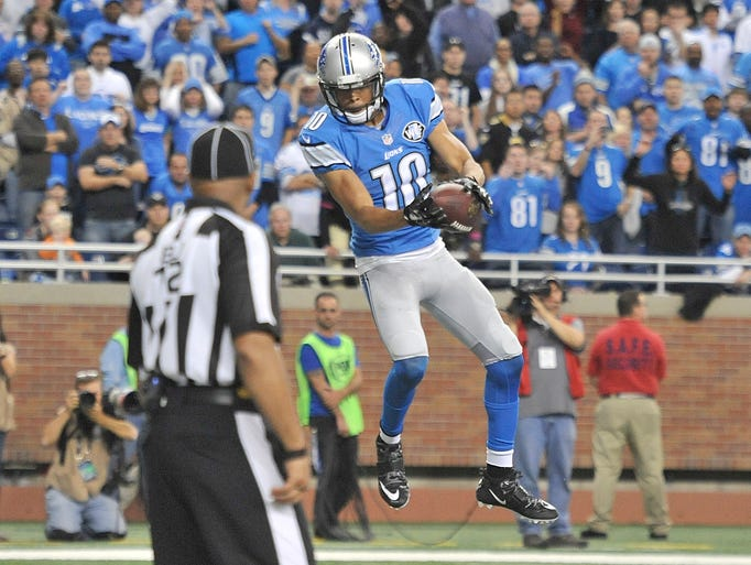 Lions Corey Fuller pulls down the game-winning touchdown