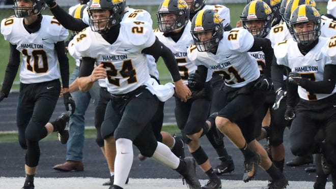 The Hamilton football team faces Godwin Heights in the playoff opener.