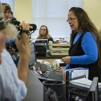 Rowan County Clerk Kim Davis, right, argues with David Moore and David Ernold, after they were denied a marriage license at the Rowan County Courthouse in Morehead Sept. 1.