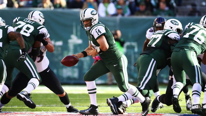 Ryan Fitzpatrick #14 of the New York Jets in action against the Baltimore Ravens during their game at MetLife Stadium on October 23, 2016 in East Rutherford, New Jersey.