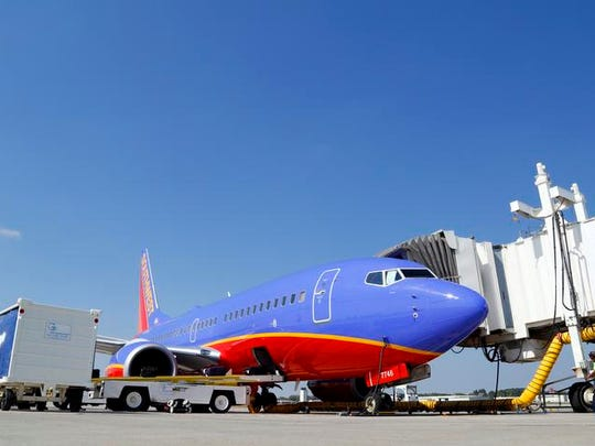 A Southwest Airlines plane is serviced at the gate at the Des Moines International Airport.