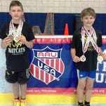 The South Lyon Matcats' Travis Richardson (left) and Jack Toth both competed in the AAU Eastern Grand National wrestling tournament held July 7-9 at the Wings Event Center in Kalamazoo. Richardson was a triple crown national champion taking firsts in freestyle, Greco Roman and folkstyle, while Toth was runner-up in both freestyle and Greco Roman in his respective weight and age group.