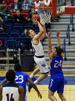 USI's Alex Stein (20) makes a layup against the Ohio Valley Fighting Scots in Evansville, Ind., Sunday, Dec. 31, 2017. The Screaming Eagles defeated the Fighting Scots, 95-69, in their last non-conference game of the season.