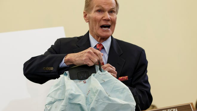 Senate Commerce Committee member Sen. Bill Nelson, D-Fla., displays the parts and function of a defective air bag made by Takata of Japan that was  linked to multiple deaths and injuries in cars driven in the U.S., during the committee's hearing on Capitol Hill in Washington on Nov. 20, 2014.