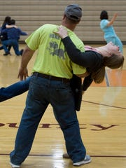 """Scott Givens dips his daughter, Kaci, at the end of their waltz practice for the 2017 prom waltz at Henderson County High School's gymnasium Monday evening. The 2017 prom is Saturday evening at County High. The theme is """"Rustic Romance."""""""