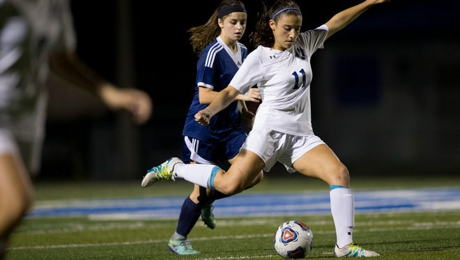 Barron Collier's Sierra Rincon (11) winds up for a kick in the first half of the Class 3A-District 14 Championship game at Barron Collier High School Friday, Jan. 20, 2017 in Naples. Barron Collier would take a 1-0 into halftime.