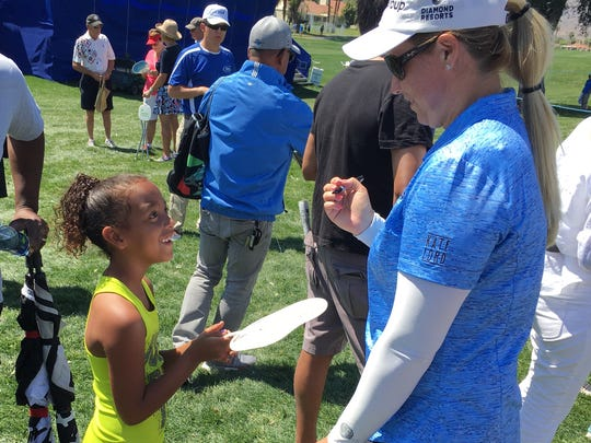 Two-time champion Brittany Lincicome makes a beaming fan's day with an autograph at the ANA Inspiration in the 2018 event. Lincicome recently announced she is pregnant but will play in the 2019 tournament in Rancho Mirage.