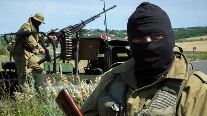 Pro-Russia fighters guard a position during a patrol near Luhansk, eastern Ukraine.