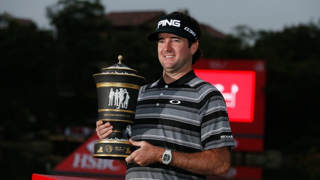Bubba Watson holds the trophy after winning the HSBC Champions on Sunday. Watson closed with 11-under 277.