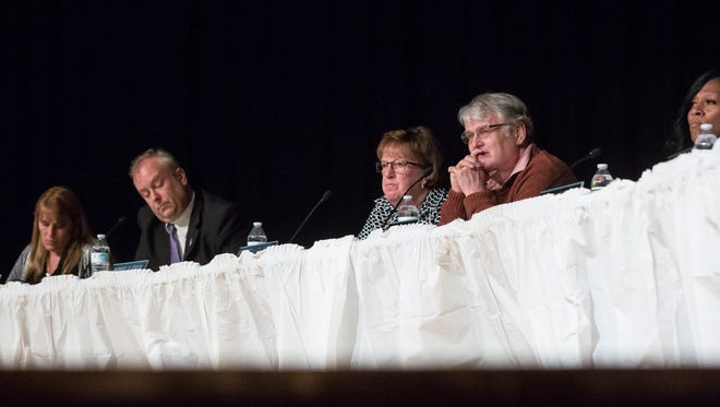 Muncie school board members Debbie Feick and Andy Warrner, third and fourth from left, and Superintendent Steven Baule listen to public concerns at a meeting earlier this year.