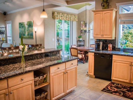 The kitchen in the Lollar home features modern and convenient touches.