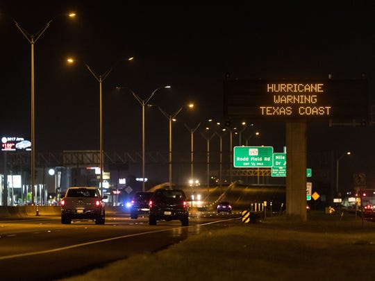 A sign over S. Padre Island Drive alerts residents on Hurricane Harvey's approach in August.