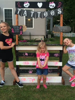 The Lein family set up a temporary tattoo stand to raise money for cancer patients.
