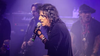 Alice Cooper performs with Hollywood Vampires, including Johnny Depp (right) at the 15th annual Christmas Pudding concert.